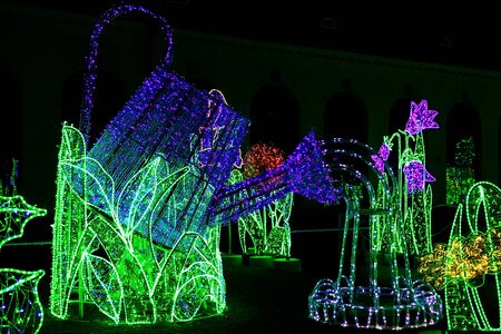 illuminated: Construction of Watering Can Illuminated from Colorful Lamps in Garden of Lights