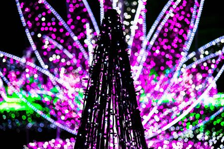 sculpture: Sculpture of Christmas Tree from Garlands against Colorful Lights