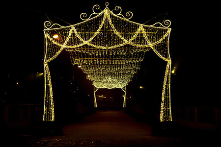 arch with canopy of christmas lights at night stock photo 48904347