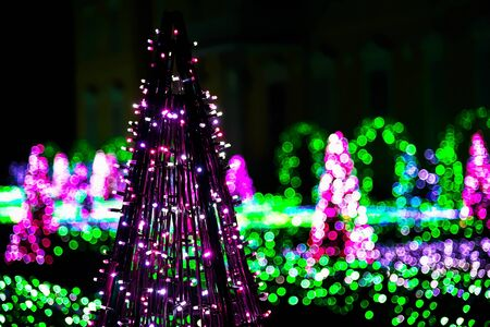 sculptures: Garden of Colorful Lights with Sculptures of Purple Christmas Trees Stock Photo