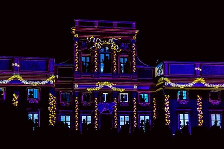 Facade of Palace or Old Building with people silhouettes. Video-Mapping show on the Facade of Wilanow Palace