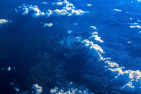Airplane view on Ocean Coast above the Clouds