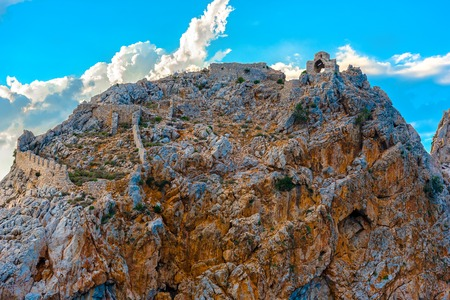 Ruins of Alanya castle at top of rock on sky background, Turkey