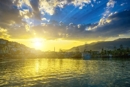 View on port with ships in Alanya at sunset, Turkey Archivio Fotografico
