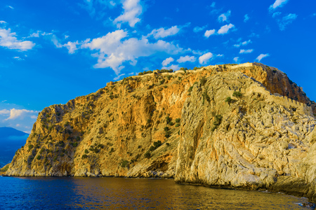 Ancient Alanya fortress on high rock by sea at sunset, Turkey