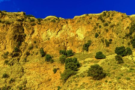 Castle wall on hill on background of blue sky in Alanya, Turkey