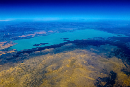 Airplane view on mountain with lake from above