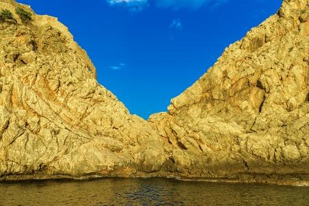 View on rocky hills among sea at sundown in Alanya, Turkey