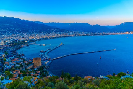 Aerial view on Red Tower (Kizil Kule) and harbour from Citadel of Alanya at sunset, Turkey