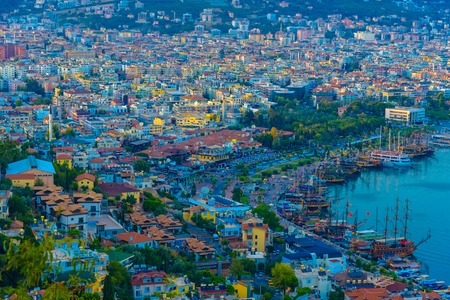 View of Alanya city and coastline with ships at sunset, Turkey