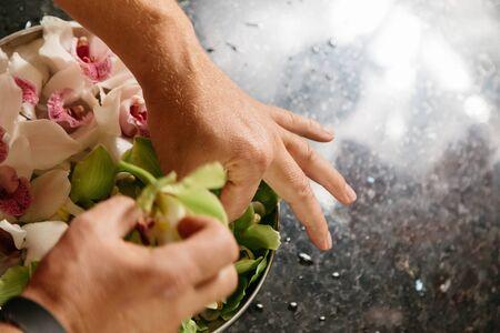 orchidea: Man making flowers arrangment orchids
