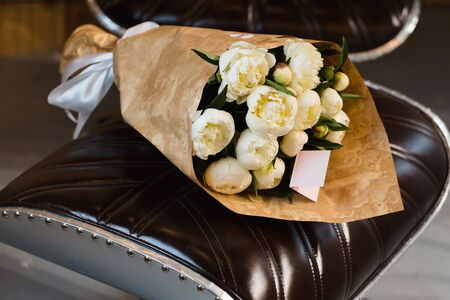 peonies: Luxury bouquet of white peonies at interior