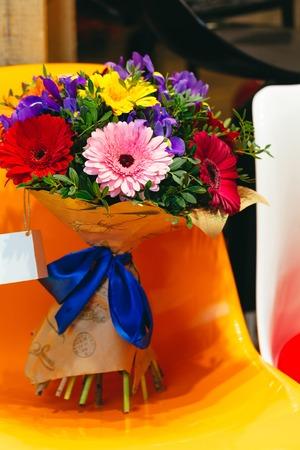 Flowers bouquet of gerbera, iris, pistacia on coloroful background