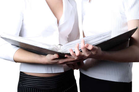 consider: Two girls at office cost and consider documents
