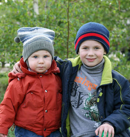 Two small boys on walk in the spring Stock Photo