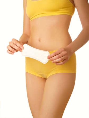 menstruacion: Cuerpo femenino perfecto aislado en blanco. Tamp�n en las manos