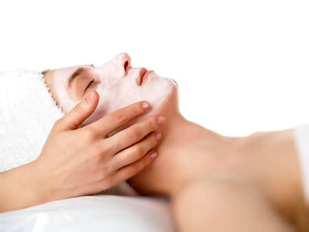 cleanser: face of women getting a spa treatment