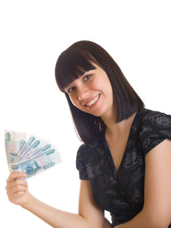 The young girl holds in hands Russian money for a white background Stock Photo - 5140793