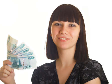 The young girl holds in hands Russian money for a white background Stock Photo - 5143074