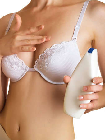 Woman applying creme to her breast