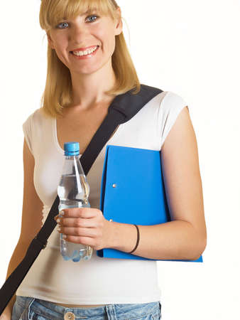 Portrait of a young attractive student, it holds a bottle with water on the white background Stock Photo - 5227612