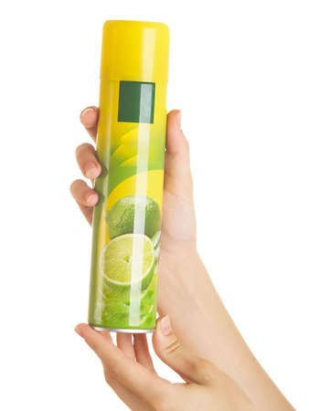 Spraying deodorant on a white background in female hands Stock Photo - 5310944