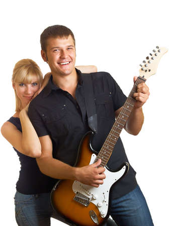 a guitarist boy playing guitar: Happy pair - the guy with a guitar Stock Photo