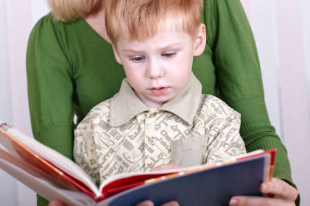 Little son with mother read the book  Stock Photo