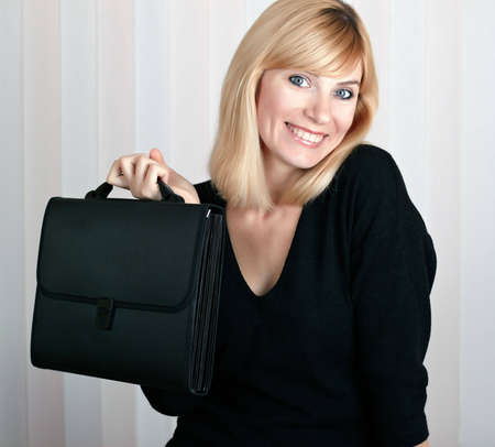 business woman smiling and holding a portfolio isolated on white photo