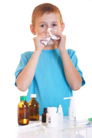 The boy wipes a napkihe nose