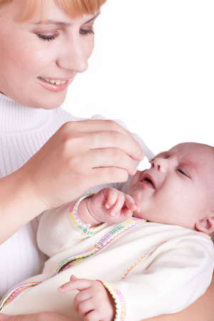 Mum digs in a medicine in a nose to the child