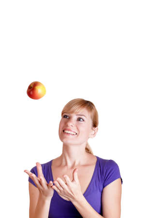 Beautiful woman playing with apple isolated on white background  photo
