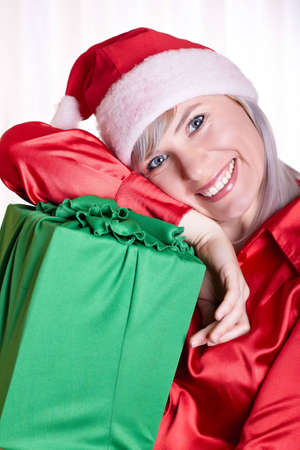 The woman in a suit of a Snow Maiden with gifts