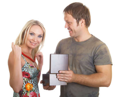 reaches: The man and the woman look at the open casket Stock Photo