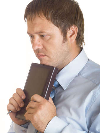 Portrait of the thoughtful businessman with a notebook  photo
