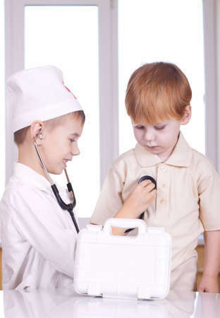Small children play hospital and doctor
