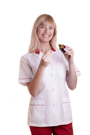 The nurse in a white dressing gown costs on a white background photo