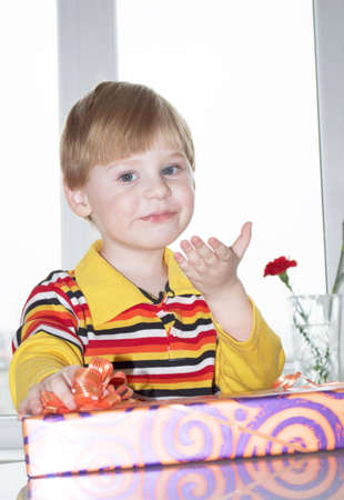 Portrait of the little boy with a gift box on a background Stock Photo - 6927735