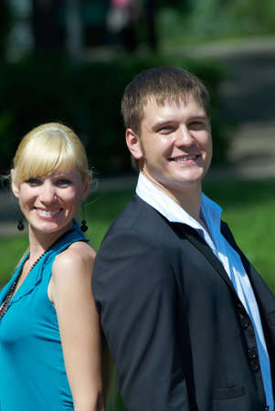 portrait of a happy young couple in park