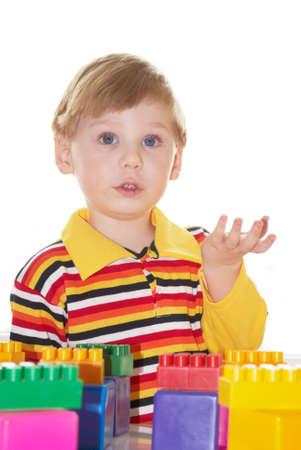 The beautiful little boy poses on white background Фото со стока