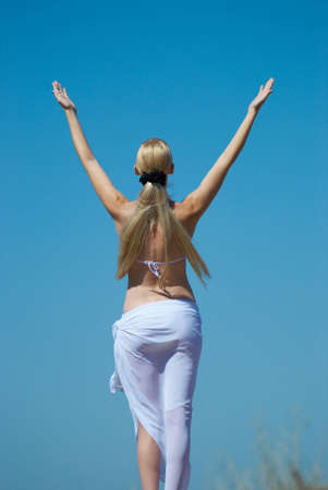 The girl in a bathing suit on a background of the dark blue sky Stock Photo