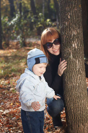 Baby boy with mother play in park Stock Photo