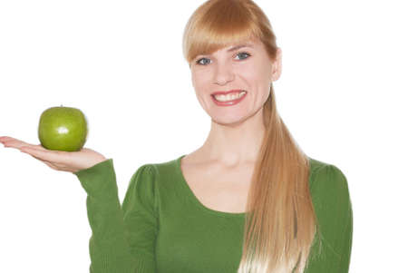 Green apple in a hand on white background