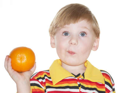 The child with an orange in a hand Stock Photo