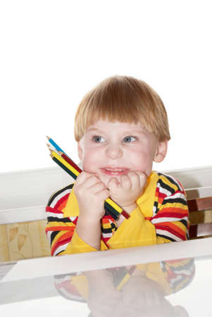 Portrait of the little boy with pencils in a hand