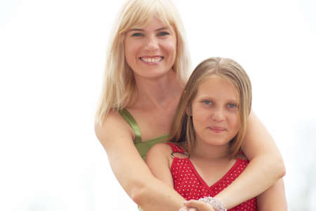 Mum With the daughter on white background Stock Photo