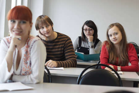 The students on employment sits at a table indoors