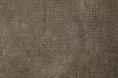 The texture of the fabric is burlap brown. Natural textiles rusty surface. Close-up, rectangular photo.