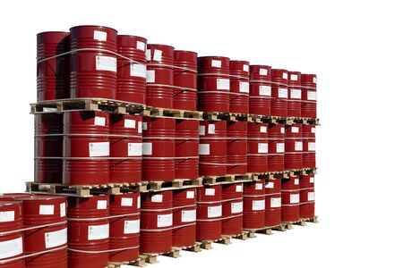 Red barrels of 200 liters for gasoline, oil, oil, paint. Many barrels stand in a row on pallets. Hazardous liquid in steel barrels. Isolated white background. Reklamní fotografie
