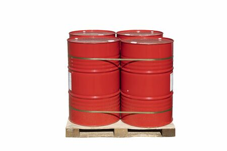 Four red barrels of 200 liters for liquid. Barrels stand on a pallet. Hazardous liquid in steel barrels. Isolated white background.